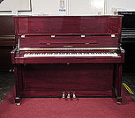 Piano for sale. A brand new, Feurich Model 122 upright piano with a mahogany case and brass fittings.
