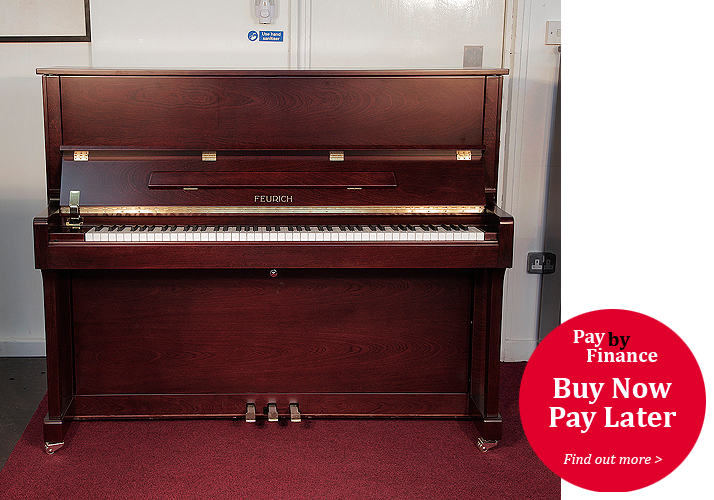 Brand New, Feurich Model 122 upright Piano for sale with a satin, walnut case.