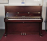 Piano for sale. A brand new, Feurich Model 122 upright piano with a satin, walnut case and brass fittings.