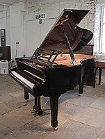 A preowned, Feurich Model 178 Professional grand piano with a black case, openwork music desk and brass fittings