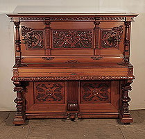 Neoclassical, Hupfer upright piano for sale with an ornately carved, mahogany case and turned, legs.