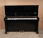 Piano for sale.  Kawai BS-11 upright piano with a black case and polyester finish. Piano has an eighty-eight note keyboard and three pedals.