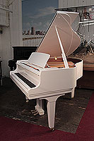 A 2019, Kawai GL-10 grand piano for sale with a white case and square, tapered legs