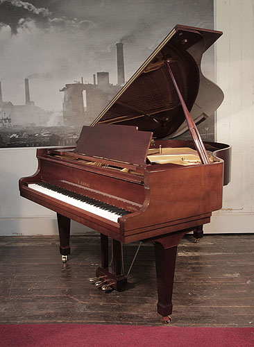 Piano for sale. A 1972, Kawai KG-2C grand piano for sale with a walnut case and spade legs Piano has an eighty-eight note keyboard and a three-pedal lyre.