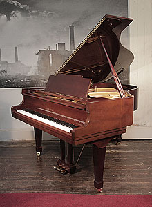 A 1972, Kawai KG-2C grand piano for sale with a walnut case and spade legs  Piano has an eighty-eight note keyboard and a three-pedal lyre.