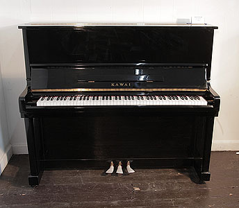 A Kawai KU-1B upright piano with a black case and polyester finish £3900 Price includes:     First tuning free | Free  piano stool | Free delivery to a ground floor residence within mainland UK.  0% finance available subject to terms and conditions.