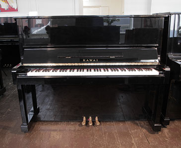 A 1985, Kawai NS-10 upright piano with a black case and polyester finish. Piano has an eighty-eight note keyboard and three pedals.   Price includes:     First tuning free | Free  piano stool | Free delivery to a ground floor residence within mainland UK.  0% finance available subject to terms and conditions.