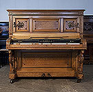 Piano for sale.  Antique, Kohl upright piano for sale with a bird's eye maple and satinwood case. Cabinet features carved winged lion legs, strapwork, rosettes and ornate brass candlesticks