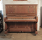 Piano for sale.  Kohl upright piano for sale with a walnut case and three turned, column legs. Entire cabinet inlaid with contrasting ebony and mother of pearl in a stylised floral design