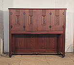 Piano for sale.  Mayer upright piano for sale with an Arts and Crafts style cabinet with carved panels and decorative hinges and candlesticks
