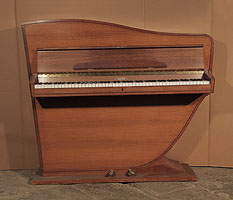 A Rippen upright grand piano with a polished, walnut case. The cabinet follows the sinuous line of the internal grand piano frame