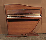 Piano for sale. A Rippen upright grand piano with a polished, walnut case. The cabinet follows the sinuous line of the internal grand piano frame
