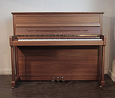 Sauter upright piano with a satin, walnut case