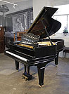 Piano for sale. Antique 1900, Steinway Model A grand piano for sale with a black case, filigree music desk and spade legs.