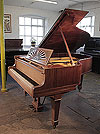 Unrestored, 1915 Steinway Model A grand piano for sale with a rosewood case, cut-out music desk in a sunset design and spade legs. Piano has an eighty-eight note keyboard and a three-pedal lyre.