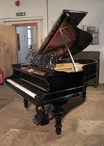 An 1879, Steinway Model A grand piano for sale with a black case, filigree music desk and carved, turned legs