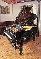 An 1885, Steinway Model A grand piano for sale with a black case, filigree music desk and fluted, barrel legs. Piano has an eighty-eight note keyboard and a two-pedal lyre with chrome foot plate.