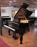 Restored, 1881, Steinway Model B grand piano with a black case, music desk in a foliar cut-out design and elephant legs. Piano has a two-pedal lyre and an eighty-five note keyboard.