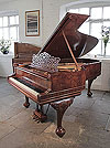 An 1896, Steinway Model B grand piano for sale with a burr walnut case, filigree music desk and Queen Anne style, cabriole legs. Piano has a three-pedal lyre and an eighty-five note keyboard.