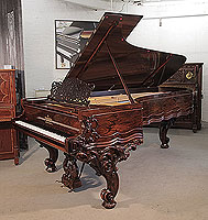An 1874, Steinway & Sons Model D concert grand piano for sale with a rosewood case, filigree music desk and ornately carved, reverse scroll legs