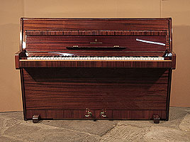 A 1960, Steinway Model F upright piano with a mahogany case and polyester finish