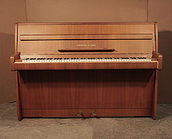 A 1965, Steinway Model F upright piano with a polished, walnut case