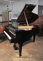 Restored, 1936, Steinway Model M grand piano for sale with a black case and spade legs. Piano has an eighty-eight note keyboard and a two-pedal lyre.