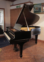 A 1902, Steinway Model O grand piano with a black case and spade legs