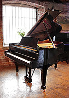 A rebuilt, 1923, Steinway Model O grand piano with a black case and spade legs. Piano has an eighty-eight note keyboard and a two-pedal lyre.