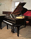 Piano for sale. A 1926, Steinway Model O grand piano with a black case and spade legs. Piano has an eighty-eight note keyboard and a two-pedal lyre.