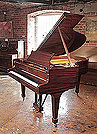 A restored, 1972, Steinway Model O grand piano for sale with a mahogany case and spade legs. Piano has an eighty-eight note keyboard and a two-pedal lyre.