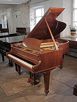 A 1959, Steinway Model O Grand Piano For Sale with a Book-Matched, Walnut Case and Spade Legs Piano has an eighty-eight note keyboard and a two-pedal lyre.