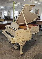 A 1979, Louis XV style, Steinway Model O grand piano for sale with an off-white case and ornately carved, cabriole legs. Entire cabinet features Rococo style, carvings accented with gilt detail. Piano comes with a matching piano stool