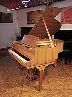 A 1966, Steinway Model S baby grand piano with a book-matched walnut case and spade legs