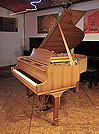 Piano for sale. A 1966, Steinway Model S baby grand piano with a book-matched walnut case and spade legs