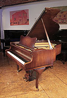 A 1954, Steinway Model S baby grand piano for sale with a polished, mahogany case and cabriole legs
