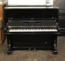 Antique, 1887, Steinway upright piano with a black case and indented front panels
