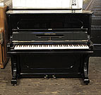 Piano for sale. Antique, 1887, Steinway upright piano with a black case and indented front panels