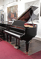 A brand new, Toyama TC-162 grand piano for sale with a black case and spade legs