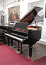 Piano for sale. A brand new, Toyama TC-162 grand piano for sale with a black case and spade legs