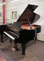 A brand new, Toyama TC-187 grand piano for sale with a black case and turned, faceted legs.