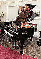A pre-owned, Wendl and Lung Model 161 grand piano with a black case and polyester finish.