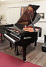 Piano for sale. A pre-owned, Wendl and Lung Model 161 grand piano with a black case and polyester finish.