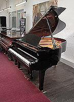 A 2003, Yamaha C2 grand piano for sale with a black case and spade legs