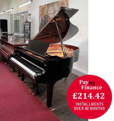 Yamaha C2 grand piano for sale with a black case and polyester finish.