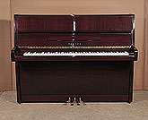 Piano for sale. A 1996, Yamaha E116 upright piano for sale with a mahogany case and polyester finish