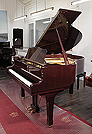 Piano for sale. A 1979, Yamaha G1 grand piano for sale with a black case and spade legs