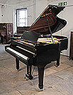 Piano for sale. A 1974, Yamaha G2 grand piano for sale with a black case and spade legs