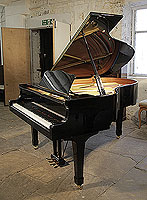 A 1993, Yamaha G3 grand piano for sale with a black case and spade legs. Piano has an eighty-eight note keyboard and a three-pedal lyre.