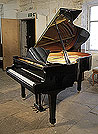 Piano for sale. A 1993, Yamaha G3 grand piano for sale with a black case and spade legs. Piano has an eighty-eight note keyboard and a three-pedal lyre.